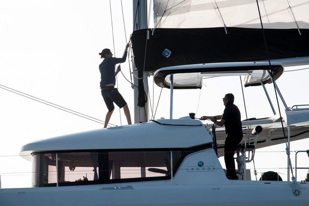 Hoisting sails on a boat